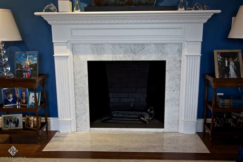 fancy marble mantel fireplace has casing white molding