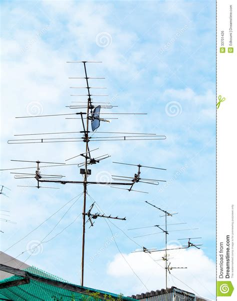 home tv antennas mounted on a roof royalty free stock