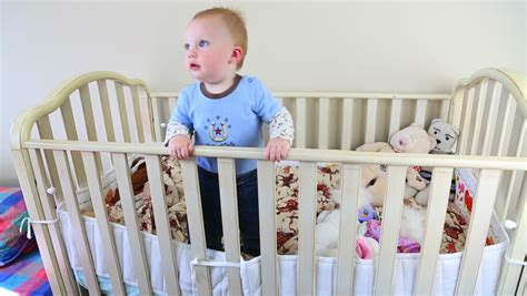 Baby Moving In Crib At by Baby His Bottle Stock Footage 4982456