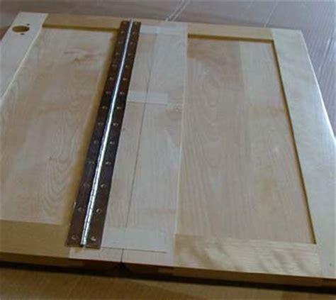 corner cabinet door hinge installation how to install piano hinge on corner cabinet home
