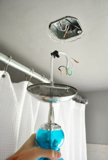 off center bathroom light fixture how to move a ceiling light to center it young house love