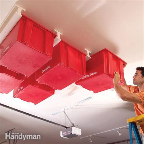 Garage Ceiling Storage Systems create a sliding storage system on the garage ceiling the family handyman