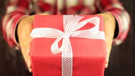 gift for man hd image gives a gift on background gift box with white ribbon opening congratulate