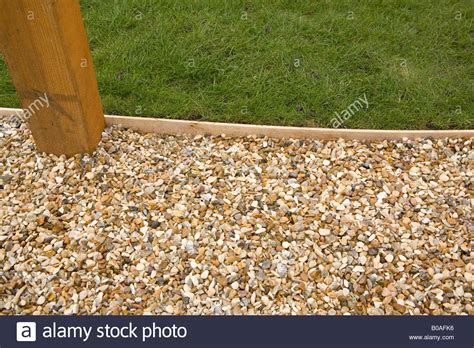 Landscape Edging Gravel Gravel Path With Wooden Lawn Edging And Pergola Base Stock
