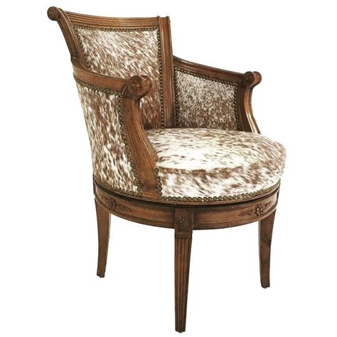 Cowhide Swivel Chair vintage swivel chair in brown and white speckled cowhide at 1stdibs