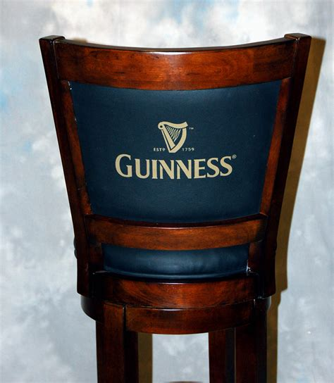 Guinness Bar Stool by Black Leather Guinness Walnut Swivel Bar Stool Ebay
