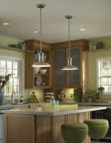Lighting over white kitchen islands top added by brown wooden kitchen