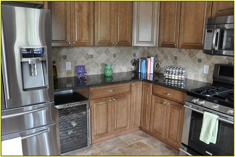 uba tuba granite with oak cabinets uba tuba granite with dark cabinets home design ideas