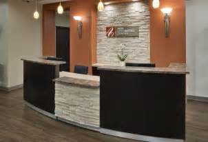 Front Desk Designs For Office New Office Ideas On Optometry Office Room And Stacked Walls