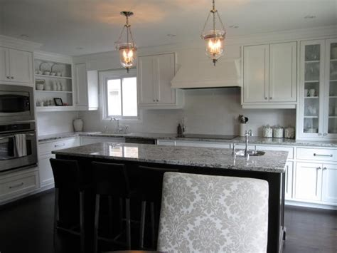bianco antico granite with white cabinets the granite gurus bianco antico and cosmic black now in
