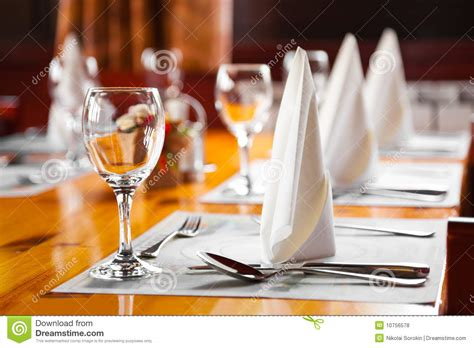 On The Table Restaurant Glasses And Plates On Table In Restaurant Royalty Free