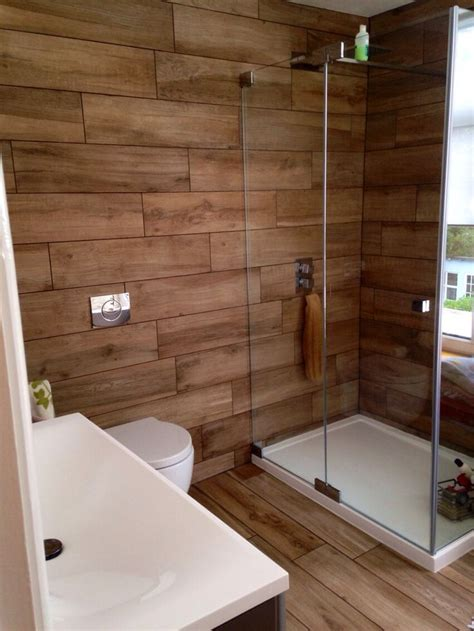 wood bathrooms wood tile shower on pinterest wood tiles faux wood tiles