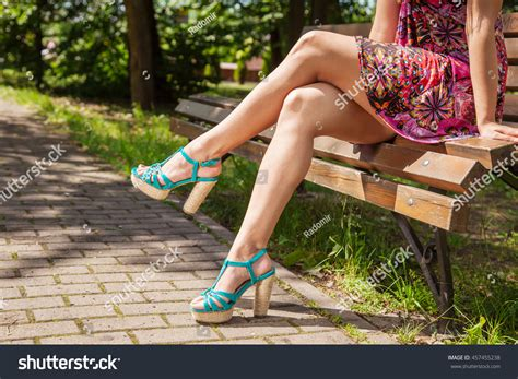 park bench legs young girl green shoes sitting on stock photo 457455238