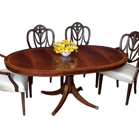 mahogany oval dining table and shield back chairs