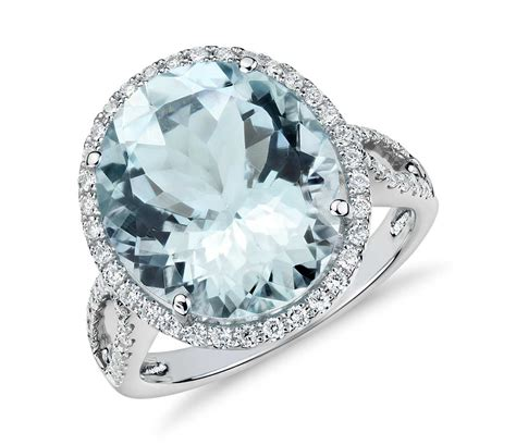 aquamarine and halo ring in 18k white gold