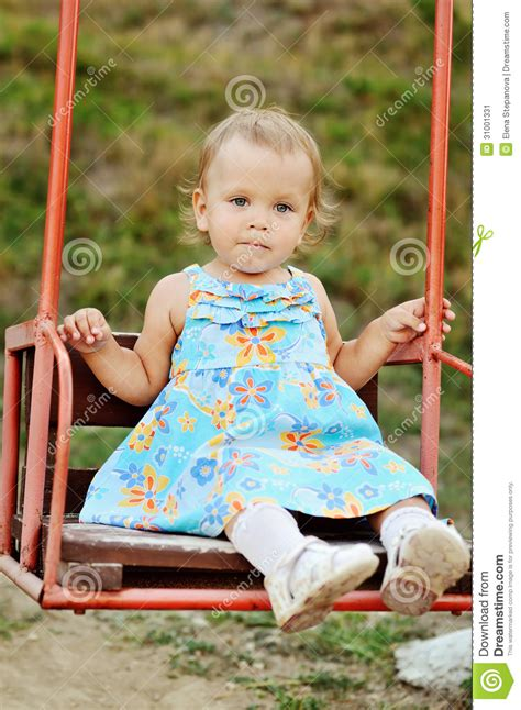 sitting on a swing girl sitting on swing stock image image 31001331