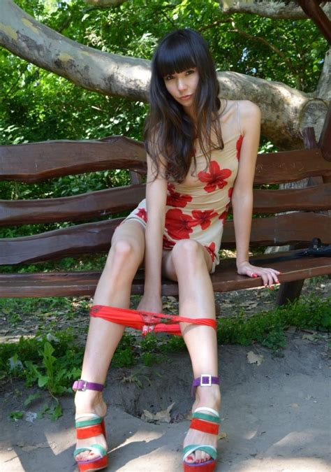 sex on the park bench brunette in a short dress on a park bench russian sexy girls