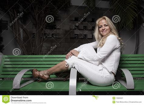 woman on bench woman sitting on a bench stock image image 13826221