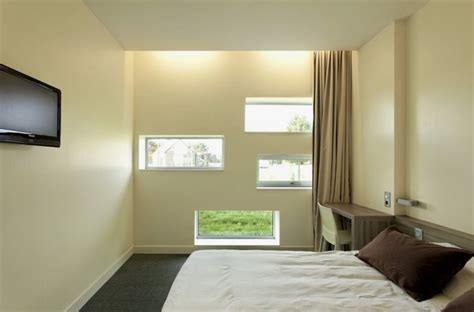 hotel rooms with multiple bedrooms hotel with multiple horizontal windows on the facade virage mulsanne hotel home