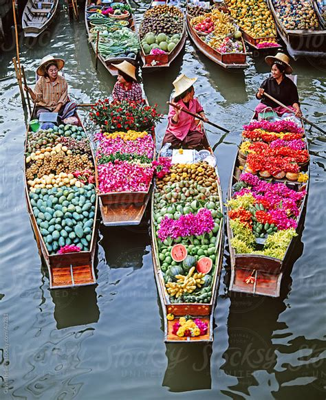 women market traders in boats laden with fruit and flowers - Floating Boat Market