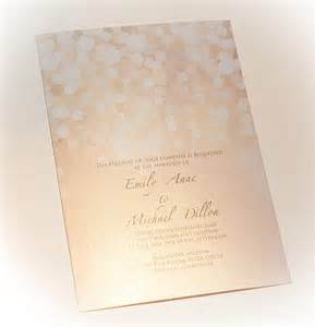 gold and blush bokeh wedding invitation printed on metallic pearl paper onepaperheart