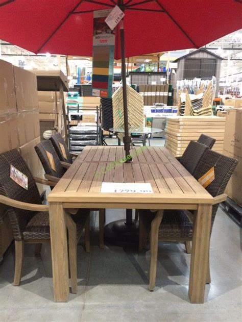 pc teak dining set with woven stacking arm chairs on