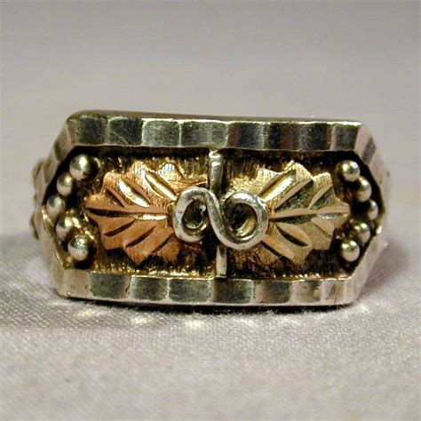 vintage sterling silver ring w 10k gold in two tones from