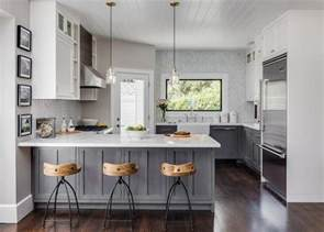 White And Gray Kitchen Cabinets by Gray Distressed Kitchen Cabinets With Marble Herringbone