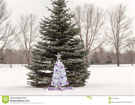 small white christmas tree with purple and silver
