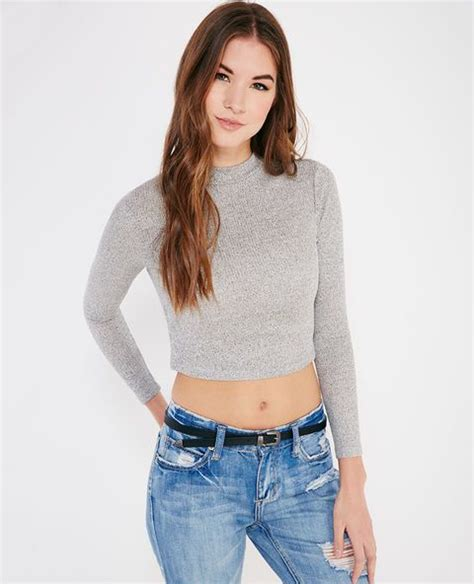 Knit Top Bahan Spandek Soft Fit To L this trendy crop top features a soft ribbed knit a mock neckline and a stretchy snug fit