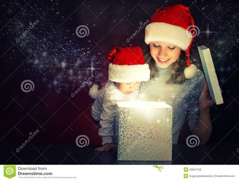 christmas magic gift box and a happy family mother and