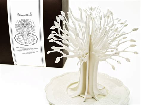 paper tree deodorant diffuser on packaging of the world