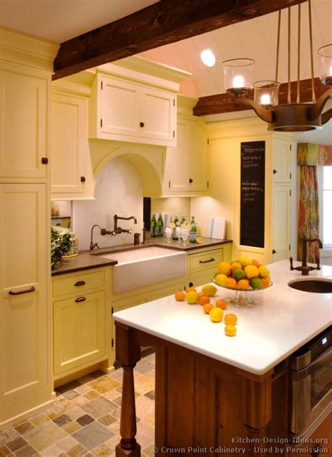 traditional yellow kitchen with a custom wood island pictures of kitchens traditional two tone kitchen