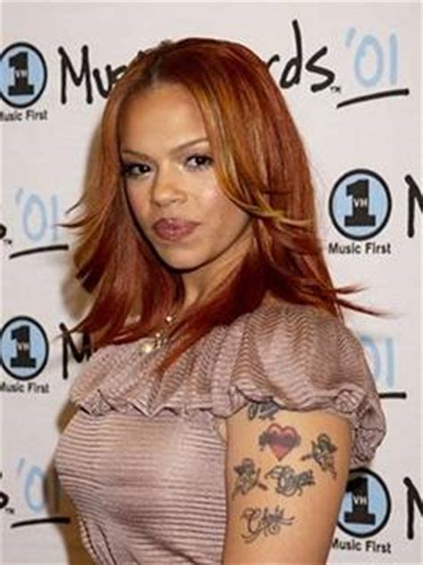 faith evans tattoo faith tattoos tattooed