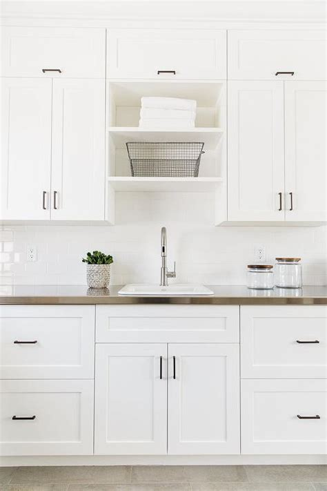 white cabinets laundry room floor to ceiling gray laundry room cabinets transitional