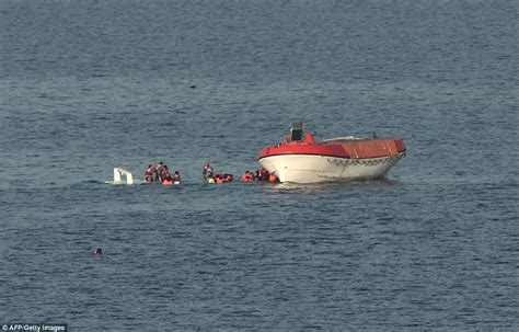refugee boat conditions greek passenger ferry sends lifeboats to rescue refugees