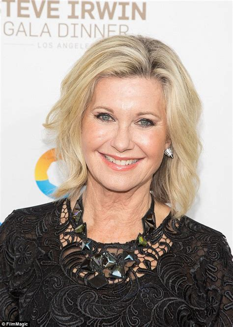 olivia newton john latest olivia newton john denies having plastic surgery daily