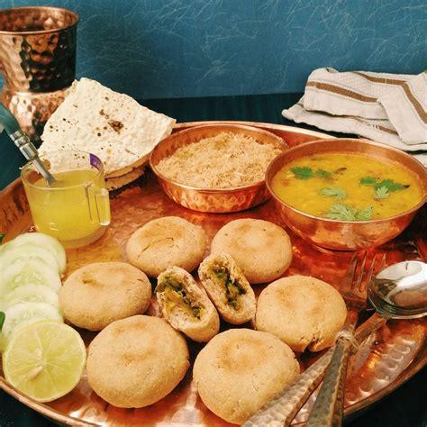 Rajasthani Kitchen by Baked Stuffed Baati With Churma And Panchratna Dal Recipe