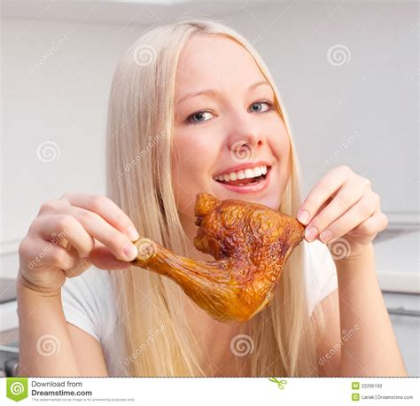 Kitchen Area Design woman eating chicken stock photography image 22295192