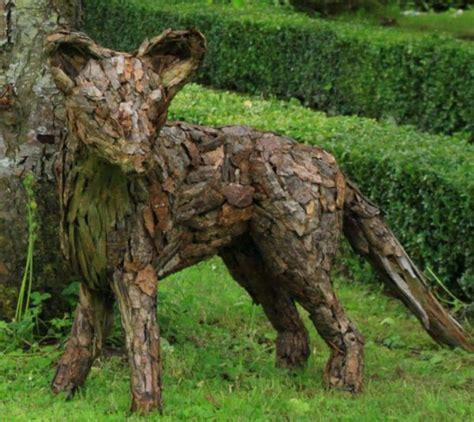 metal garden animals sculpture fox scrap wood and bark