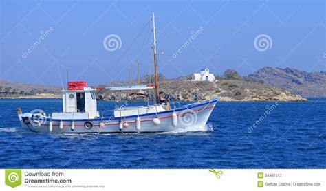 greek fishing boat plans fishing boat in greece stock image image of ocean shore