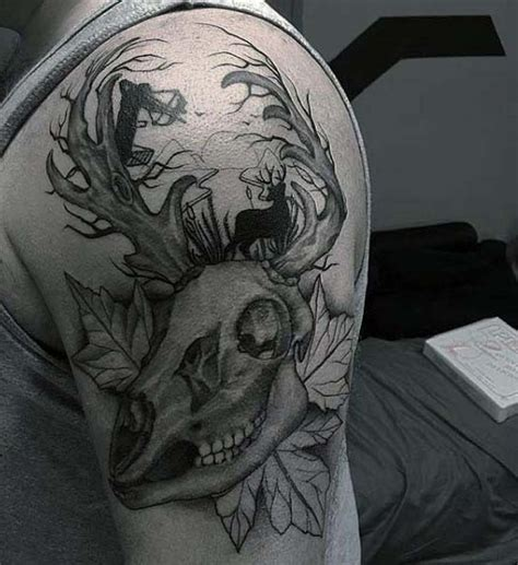 animal tattoo upper arm unusual black ink animal skull with leaves tattoo on upper