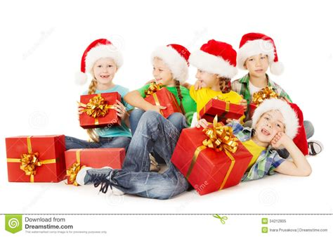 christmas helpers kids in santa hat holding presen stock