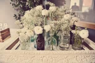 Cherry plum events vintage wedding centerpiece with wild flowers