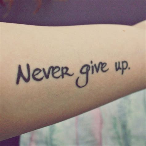 22 superb never give up tattoo design and ideas