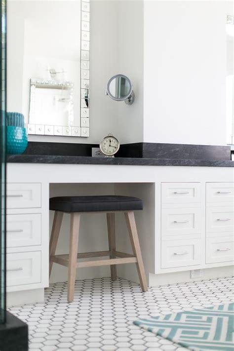 black and white bathroom with black vanity stool