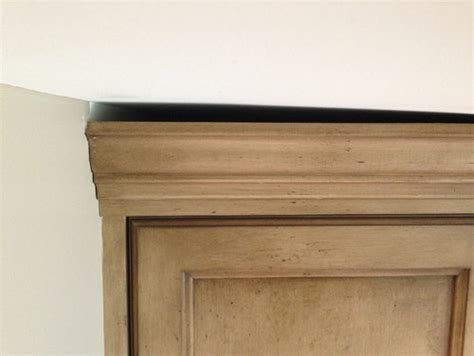 how to fill gap between cabinet and ceiling how to fix gap between ceiling and kitchen crown molding