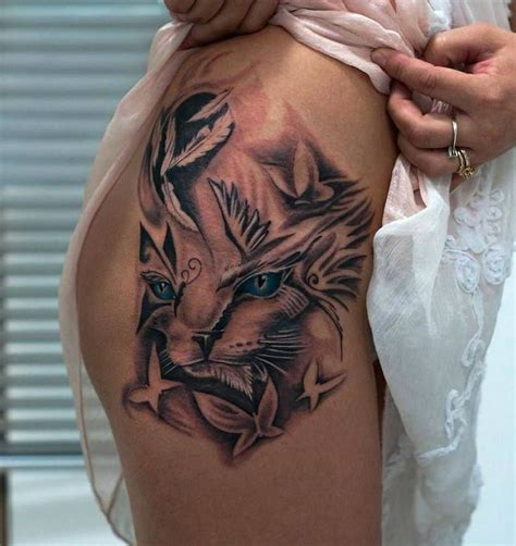 hip tattoo cat butterflies and feathers tattoos