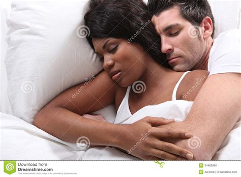 husband and snuggling in bed stock photo image