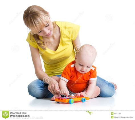 Play Musical Baby baby and his play musical toys stock photo image